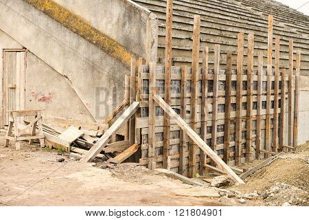 wooden scaffolding for repairing a stadium. Construction