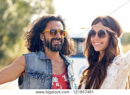 summer holidays, road trip, vacation, travel and people concept - smiling young hippie couple over minivan car