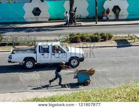 Street Sweeper Worker With His Handcart