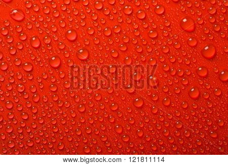 beautiful fresh Water Drops On Red Background