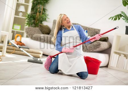 Humorous housewife with jogger stick make joke