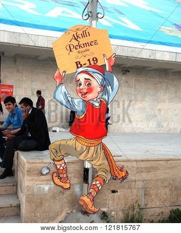ANKARA/TURKEY-JUNE 7, 2012-Hero Tale's character Bald Boy (Keloglan) at the advertisement stand during the