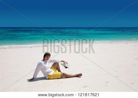Summer. Relax. Successful Handsome Man Resting On Exotic Beach With Blue Water And White Sand. Vacat