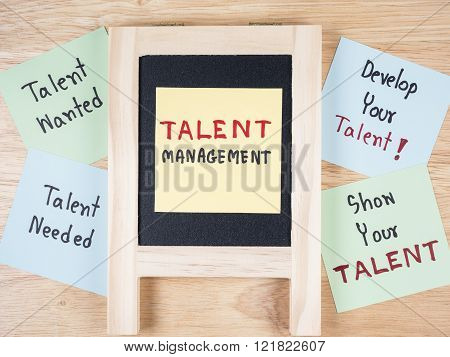 Handwriting Talent Management Talent Needed Talent Wanted develop your talent show your talent on colorful note paper and blackboard with wood background.