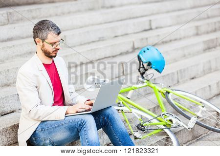 Male Commuter In London Working With Laptop Computer