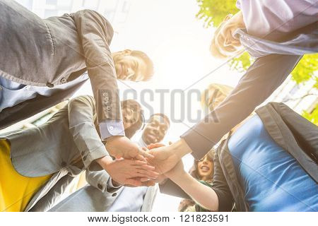Group Of Business People With Hands On Stack