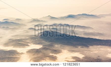 Panoramic View Of Mountains And Clouds From Airplane