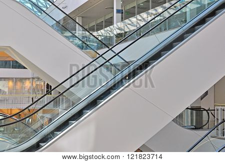 Two escalators of the empty shopping mall