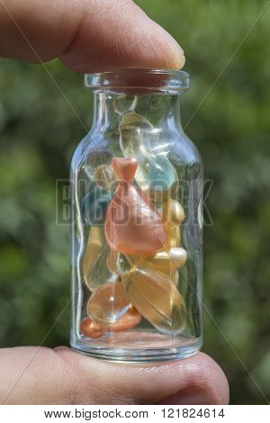 Gel capsules in a glass bottle