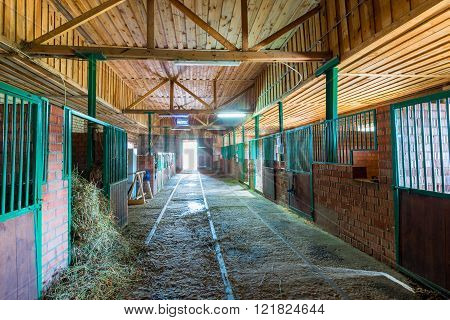spacious stables empty building in the countryside
