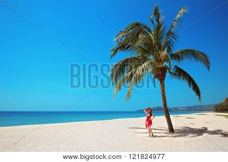 Palm Tree. Beautiful Woman On Exotic Beach. Carefree Young Girl Relaxing On Tropical Seashore. Vacat