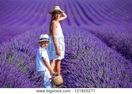 Kids in lavender summer field