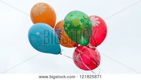Multi-colored balloons on a background of the sky