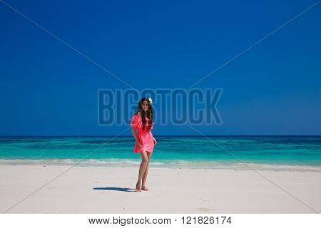 Beautiful Woman Walking On Exotic Beach, Brunette Girl Model In Red Dress On The Ocean Coast. Vacati