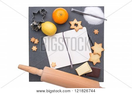 Plate of slate with different christmas items on it