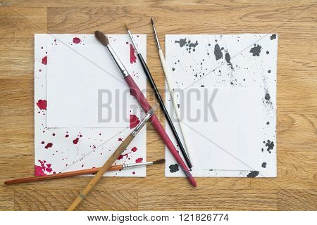 Blots Of Ink With Different Brushes On A White Paper