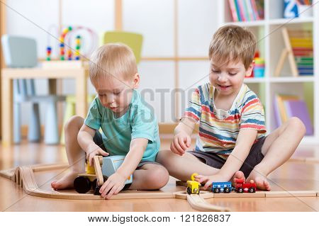 Two children little boys playing role game in daycare