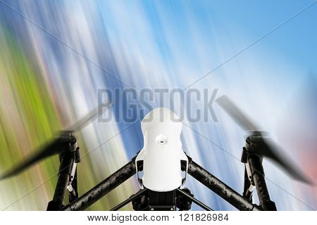 Modern drone in motion, top view.