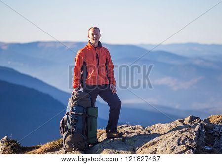 Hiker with Backpack in the wilderness on mountains
