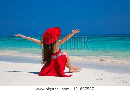 Beautiful Woman In Hat Enjoying And Relaxing On Beach With White Sand In Summer By Tropical Blue Wat