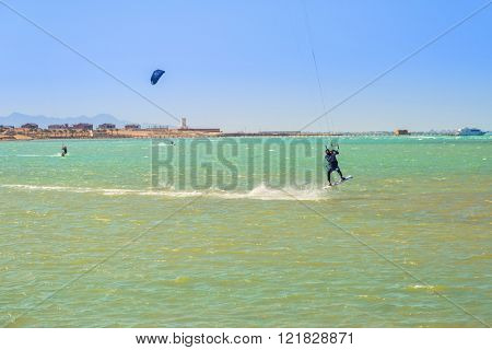 HURGHADA , EGYPT - APR 17, 2013: Kite surfers at the beach of Red Sea near Hurghada. Kitesurfing is a popular water sport in Egypt.