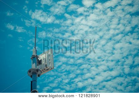 This a photo of Antenna cellular tower and blue sky