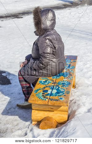 Berdsk Novosibirsk region Siberia Russia - March 13 2016: wooden bench in a city Park with a pattern in Gzhel style