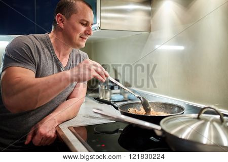 Man Cooking At Home Alone