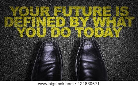 Top View of Business Shoes on the floor with the text: Your Future is Defined By What You Do Today