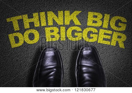 Top View of Business Shoes on the floor with the text: Think Big Do Bigger
