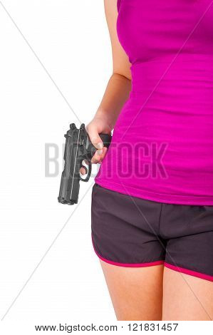 Woman wearing shorts with gun in hand