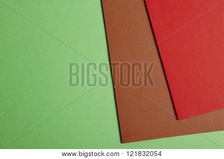 Colored Cardboards Background In Green Brown Red Tone. Copy Space