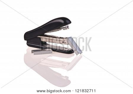 rusty stapler with staples on white background