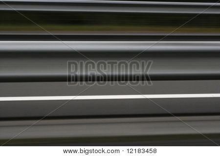 road and central barrier highspeed blur