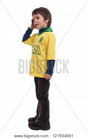 Happy handsome little boy talking on the phone