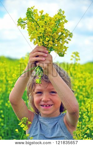 Potrait of a Smiling boy with wildflowers