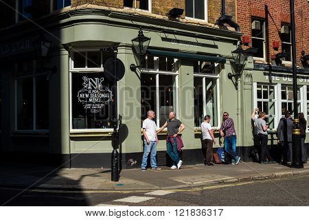 LONDON, UK - APRIL15, 2015: Exterior of pub in London with lots of people drinking and socialising after work.