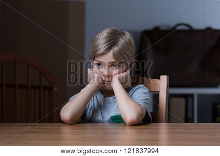 Abandoned boy feeling depressed and alone at home