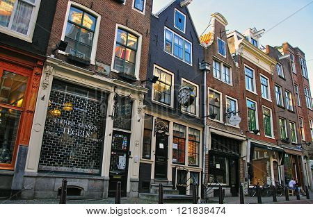 AMSTERDAM NETHERLANDS - MARCH 25: Typical street of Amsterdam city centre on March 25 2012. Amsterdam is a capital and the largest city of Netherlands.