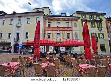 BELLINZONA SWITZERLAND - MAY 7: Street cafe in historical centre of Bellinzona on May 7 2012. Bellinzona is ancient city in italian part of Switzerland.
