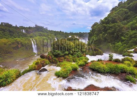 Fantastically spectacular boiling and thundering waterfalls of Iguazu. Waterfalls in Brazil. The picture was taken Fisheye lens