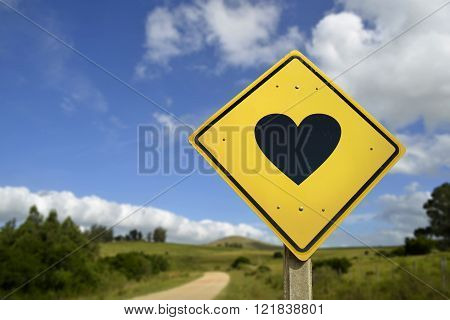Natural way to find the love of your life concept. Road sign with heart shape icon in rural scene includes copy space.