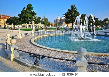PADOVA ITALY - OCTOBER 3: Central park with fountain in Padova historical center on October 3 2012. Padova is one of the most popular cities of Veneto Italy.