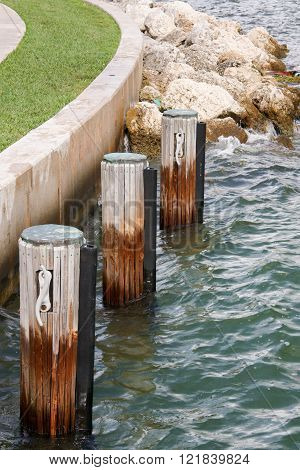 Three wooden mooring bollards in miami florida