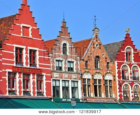 BRUGGE BELGIUM - MARCH 23: Colorful houses in the city center of Brugge on March 23 2012. Brugge is a small city and famous touristic center in the northern part of Belgium.