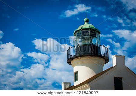 Beautiful colorful Lighthouse along Pacific Ocean coast close up fresnel lens lighting navigation for ships at sea