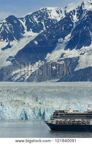 Alaskan cruise ship destination vacation with ice glacier background