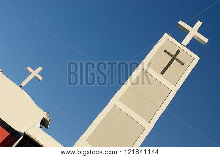white cross with blue sky of a church