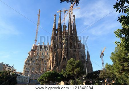 Barcelona, Spain - November 10, 2015: Basilica Sagrada Familia. The church is designed by architect Antoni Gaudi and is still under construction. It is a famous tourist attraction in Barcelona.