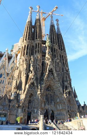 Barcelona, Spain - November 10, 2015: Basilica Sagrada Familia with Nativity facade. The church is designed by architect Antoni Gaudi and is still under construction. It is a famous tourist attraction in Barcelona.